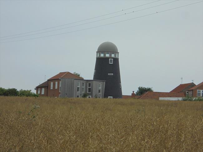 Sail-less windmill at Mill Farm, a useful landmark between points 5 and 6 of the walk.